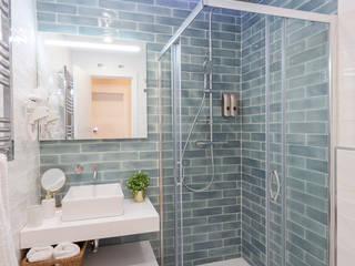 Nueva vivienda en Chueca WINK GROUP Baños de estilo ecléctico Cerámico Turquesa