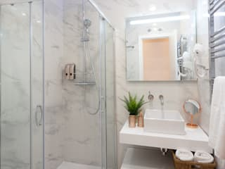 Nueva vivienda en Chueca WINK GROUP Baños de estilo minimalista Mármol Blanco