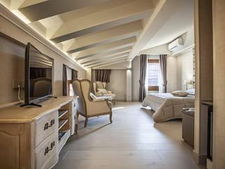 Hotel Cavour Camera da letto in stile classico di Biondi Architetti Classico