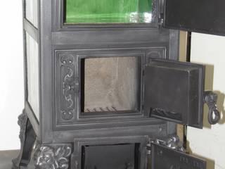Gestellkachelofen Klus Nr. 1544 originalgetreu Restauriert Esszimmer im Landhausstil von Perler Ofen GmbH Landhaus