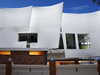 The Fabric Wave Eclectic style houses by A. J Architects Eclectic