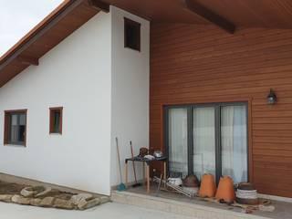 Logdomus Chalets & maisons en bois Bois massif Effet bois