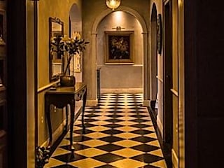 Apartment renovation in Emaar Palm Springs Gurgaon Eclectic style corridor, hallway & stairs by Stonehenge Designs Eclectic