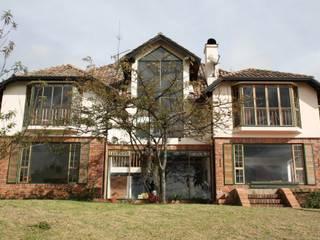 Casa Tanané V&V Arquitectos SAS Casas de estilo rural