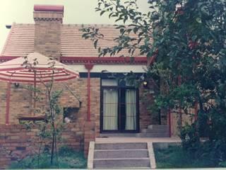 Casa Belgravia Balcones y terrazas de estilo rústico de V&V Arquitectos SAS Rústico