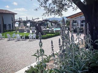 Italiano contemporaneo Bar & Club moderni di exTerra | consulenze ambientali e design nel verde Moderno