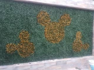 Muro verde y pasto sintético. Decora in - Hunter Douglas JardínAccesorios y decoración