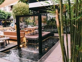 Thiết Kế Quán Cafe Sân Vườn Desworking bởi SGL LANDSCAPE ARCHITECTURE CO.,LTD Hiện đại