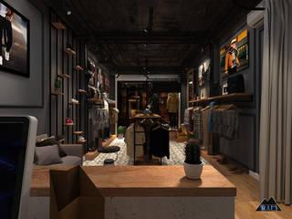 Thiết kế nội thất shop thời trang nam: công nghiệp  by Công ty trang trí nội thất RIM Decor, Công nghiệp