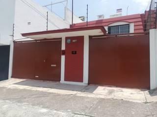 PUERTAS AUTOMÁTICAS GROSSMANN Casas de estilo minimalista Hierro/Acero
