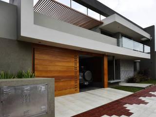 Modern Houses by KARLEN + CLEMENTE ARQUITECTOS Modern