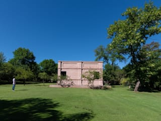 Industrial style houses by KARLEN + CLEMENTE ARQUITECTOS Industrial