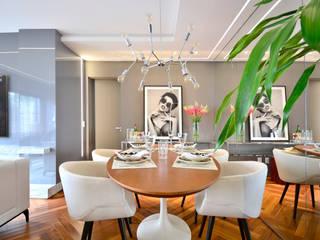 Sala de estar e lavabo Salas de jantar modernas por Juliana Damasio Arquitetura Moderno