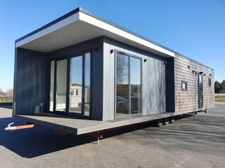 Casas de estilo moderno de DMK Budownictwo Dariusz Dziuba Sp. K., Mobilne Domki Letniskowe i Całoroczne Moderno