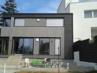 In-Architecture Dom jednorodzinny Drewno Szary