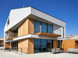 Modern houses by Atelier d'Arquitetura Lopes da Costa Modern