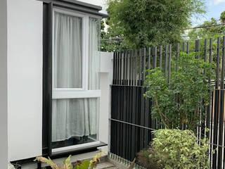 Modern garden by OASIS Design Studio Modern