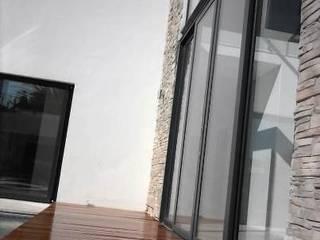 Aluminium Sliding Doors by The Renovation Guy Modern