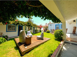 Casa de campo T8 com jardim interior, Peniche por PortugalRur Rústico