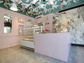 Cookie & Cake Negozi & Locali commerciali moderni di viemme61 Moderno