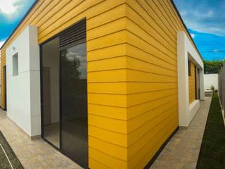 Twin House Amarilla Casas de estilo rural de Nacad Arquitectos Rural