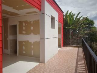 Twin House Roja de Nacad Arquitectos Rural