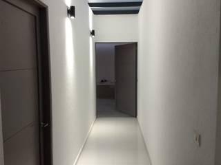 residencia de descanso Pasillos, vestíbulos y escaleras modernos de C. A. arquitectos Moderno