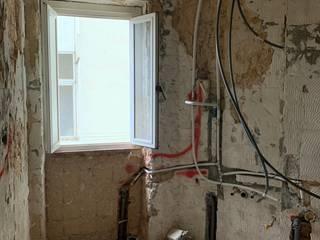 Remodelação Geral de Apartamento em Campo de Ourique por Buildemant - Construção e Manutenção, Lda