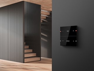 Corredores, halls e escadas modernos por Gira, Giersiepen GmbH & Co. KG Moderno