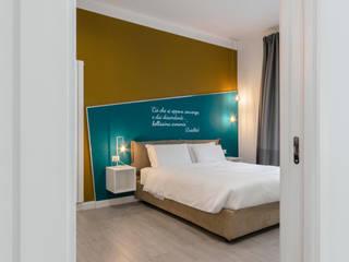 antonio felicetti architettura & interior design Modern style bedroom Wood Yellow