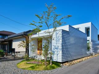 細長敷地の家 モダンな 家 の murase mitsuru atelier モダン