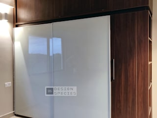 Lacquered sliding wardrobe DESIGN SPECIES BedroomWardrobes & closets MDF Brown