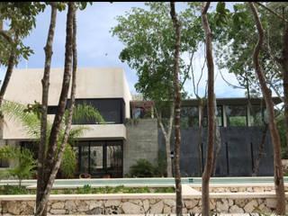 axg arquitectos Casas de estilo tropical Hormigón Blanco
