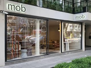 PROYECTOS COMERCIALES Merkalum Estudios y despachos modernos Aluminio/Cinc Negro