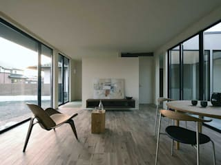 Modern living room by NASU CLUB Modern