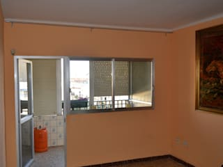 Promitec Obras SL Ruang Keluarga Modern