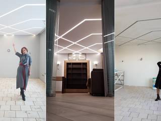 Minimalistyczny salon od Студия дизайна интерьера 'Золотое сечение' Minimalistyczny