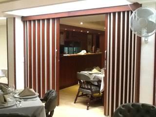 Puertas Plegables en madera PERSIANAS DE COLOMBIA Comedores de estilo moderno