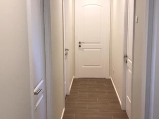 Casa IG Pasillos, vestíbulos y escaleras clásicas de ATELIER3 Clásico