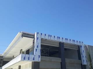 ALUCO SOLUCIONES Modern shopping centres Aluminium/Zinc Grey