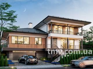 Стильный двухэтажный дом с гаражом на рельефном участке от TMV Architecture company