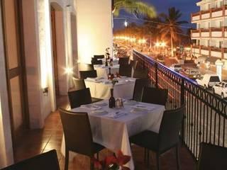 Arechiga y Asociados Asian style balcony, veranda & terrace Ceramic Brown