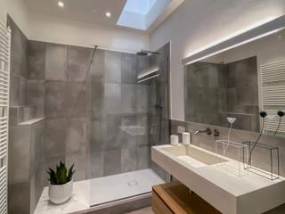 Aire Studio Associato Modern style bathrooms