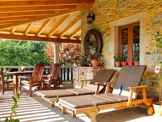 Restauración & Rehabilitación de Casa Tradicional de Piedra en Arzúa (A Coruña) Quorum, Arquitectura de Interiores & Comunicación Casas rurales Piedra Acabado en madera