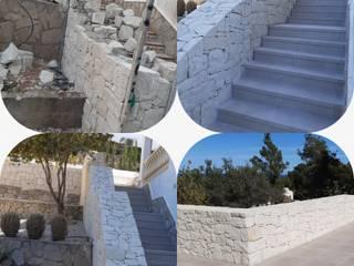 Piedra Casas de estilo mediterráneo de CONSTRUCCIONS VICTOR IVARS IVARS Mediterráneo