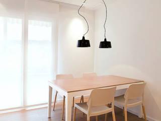 MANUEL GARCÍA ASOCIADOS Modern dining room Wood effect