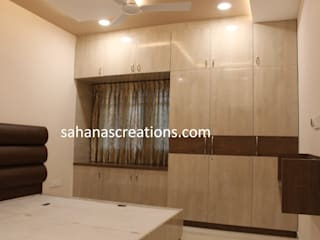 Budget Home interiors Modern style bedroom by Sahana's Creations Architects and Interior Designers Modern