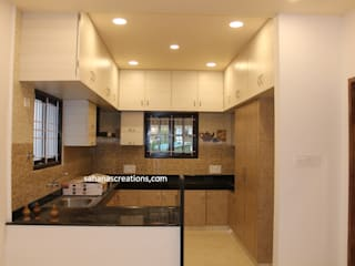 Budget Home interiors by Sahana's Creations Architects and Interior Designers Modern