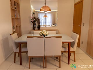 Modern dining room by Camarina Studio Modern