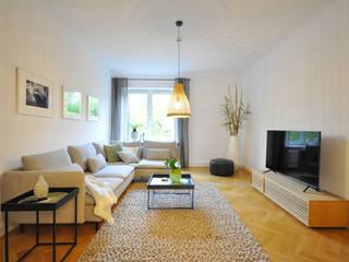 Ferienhaus Raumblüte WohnzimmerSofas und Sessel